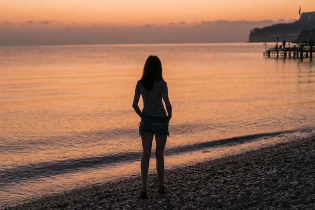Tourist at the sunrise enjoying the view Free Photo