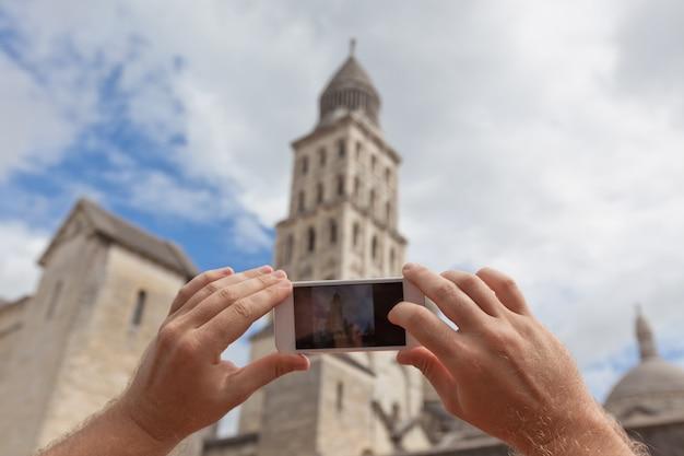 ペリグー、フランスの写真を撮る観光客 Premium写真