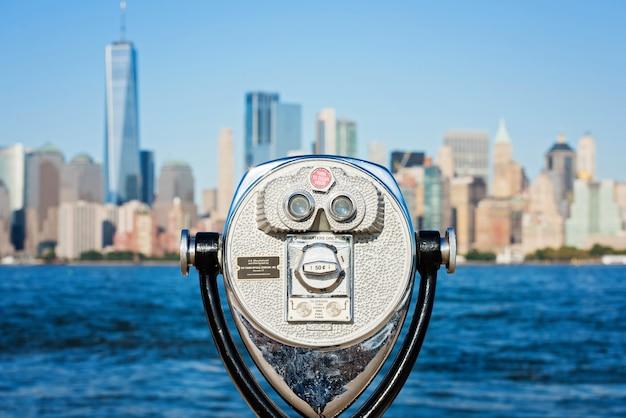 Touristic binocular on the panorama of new york city Premium Photo