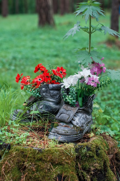 Touristic boot with flowers in the forest. Premium Photo