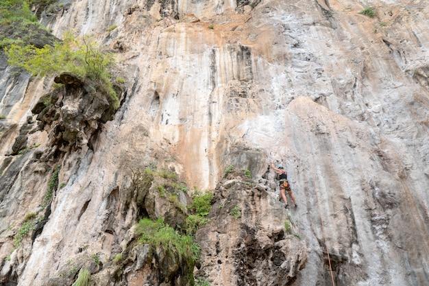 Tourists are climbing cliffs at railay bay, krabi. Premium Photo