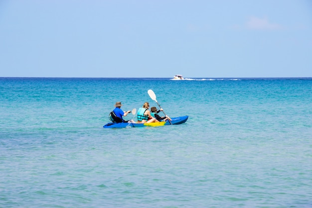 Tourists kayaking sea beautiful area ao bang bao at koh kood island trat, thailand. Premium Photo