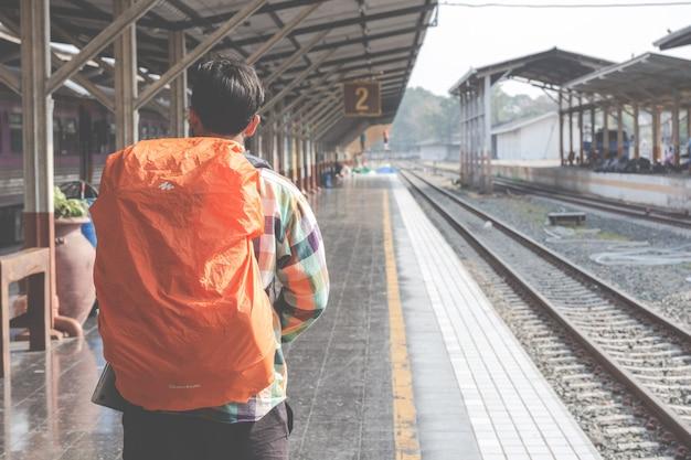Tourists travel to the train station. Free Photo
