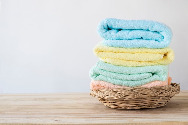 Towel on basket on wood table Premium Photo