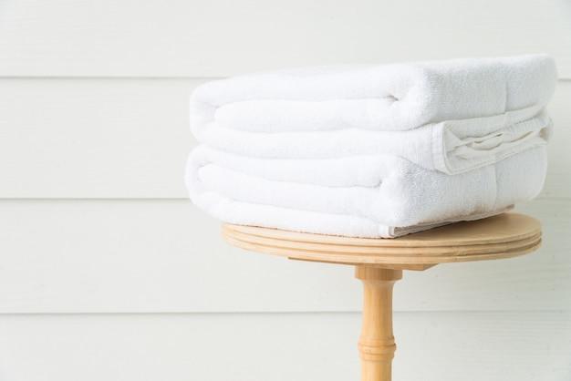 Towel bath on wood table Free Photo