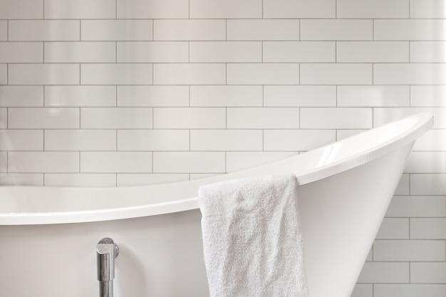 Towel on classic bathroom with old bathtub Premium Photo