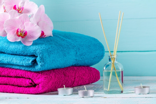 Towels on a background of blue, wooden background. hygiene. shower. bathroom. copy space Premium Photo