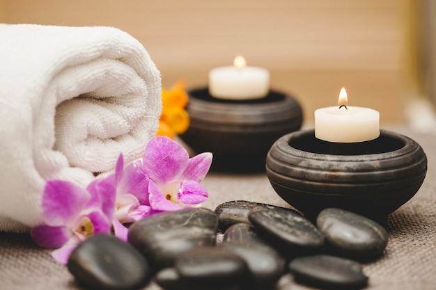 Towels, candles, stones and flowers Free Photo