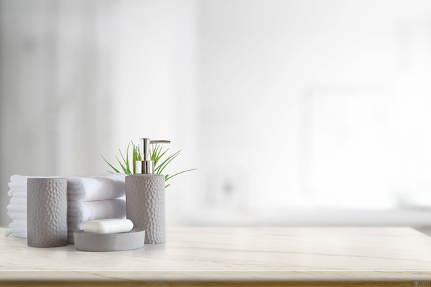 Towels and ceramics shampoo or soap on top marble table with copy space on blurred bathroom background. Premium Photo