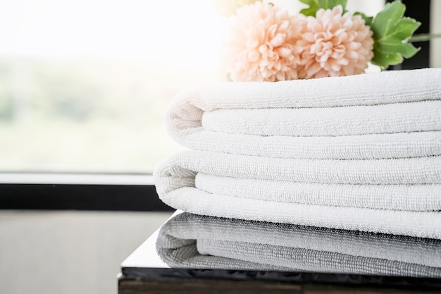 Towels and flowers on table with copy space. Premium Photo