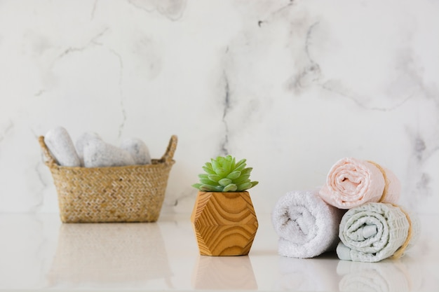 Towels set with basket on table Free Photo