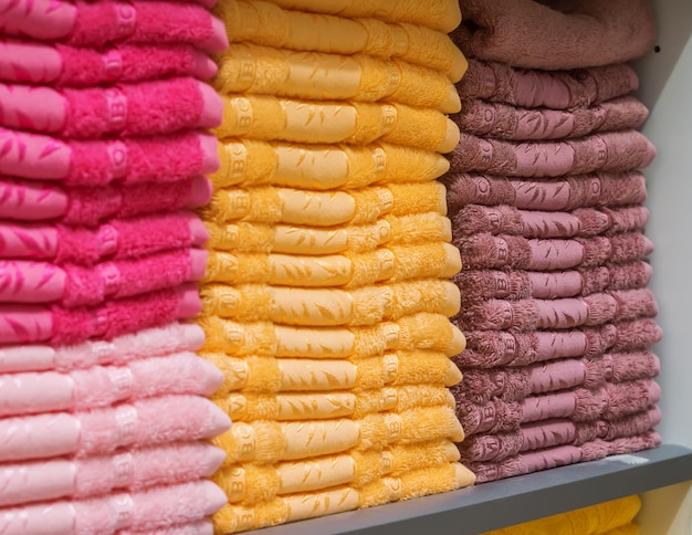 Towels on the shelf in the store. Premium Photo