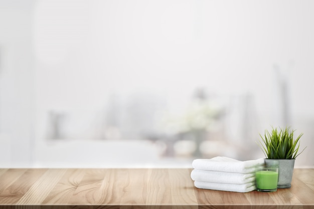 Towels and spa accessory on wood counter table Premium Photo