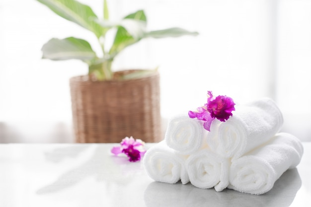 Towels on table with copy space blurred bathroom background. for product display montage. Premium Photo