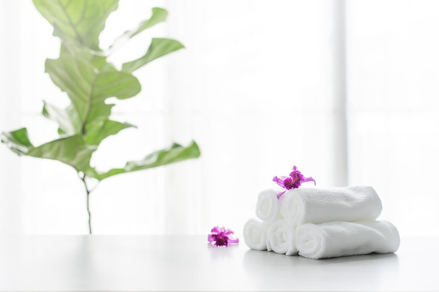Towels on table with copy space blurred bathroom background. Premium Photo
