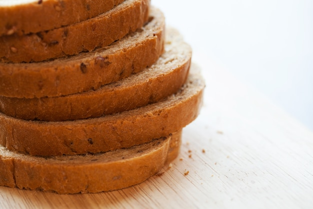 Tower of bread pieces on a table Free Photo