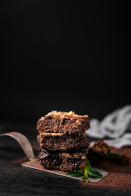 Tower of chocolate nut brownies on tray Free Photo
