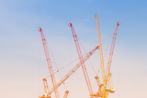 The tower crain for construction building in blue sky background Premium Photo