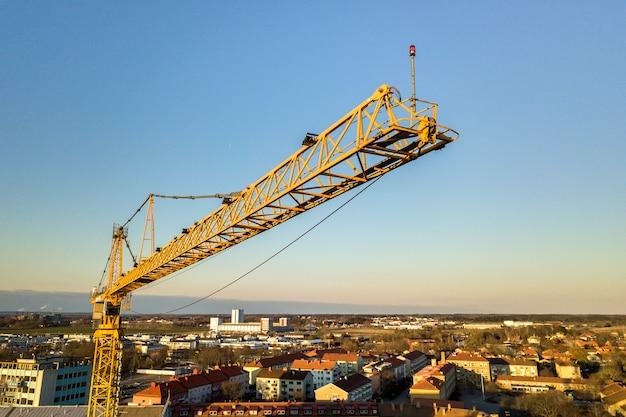 Tower crane and city landscape stretching to horizon. Premium Photo