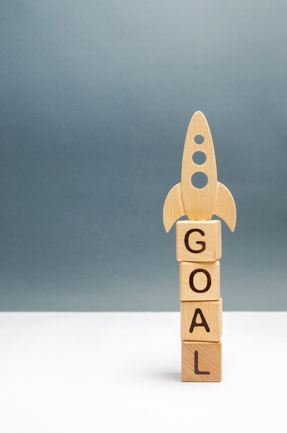 Tower of cubes with the word goal and rocket Premium Photo