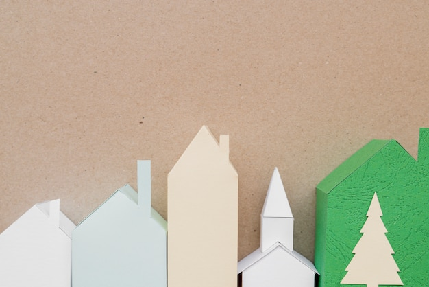 Town made with different type of paper on brown backdrop Free Photo