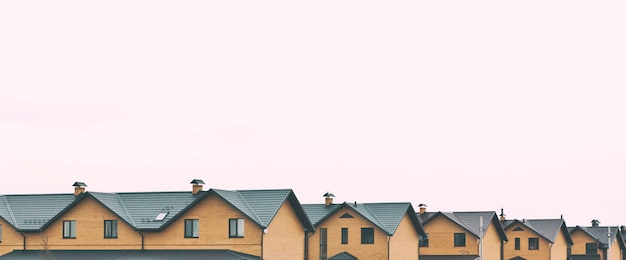Townhouses made of brick in line Premium Photo