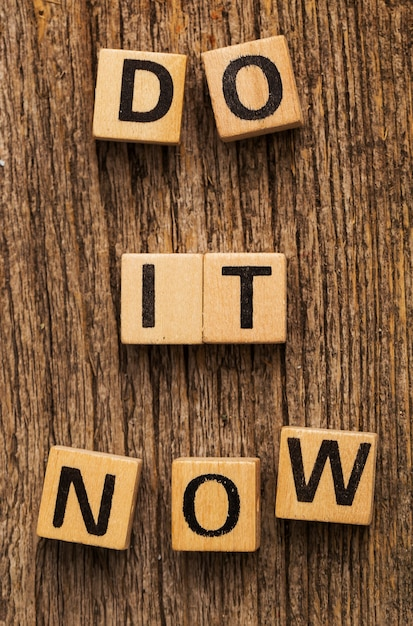 Toy bricks on the table with word do it now Free Photo