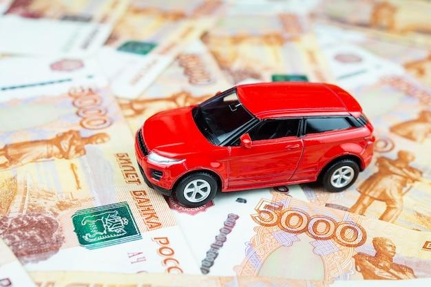 Toy car on money Premium Photo