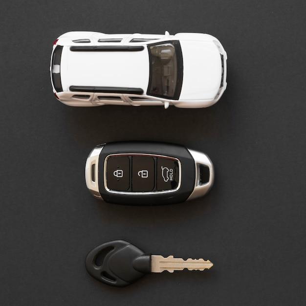 Toy car near alarm keys Free Photo