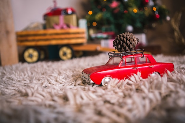 Toy car with a pine cone Free Photo