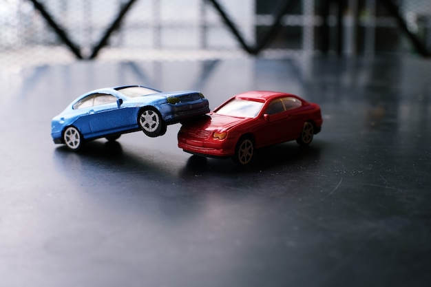Toy cars crash accident. Simulation red and blue car Photo | Premium ...