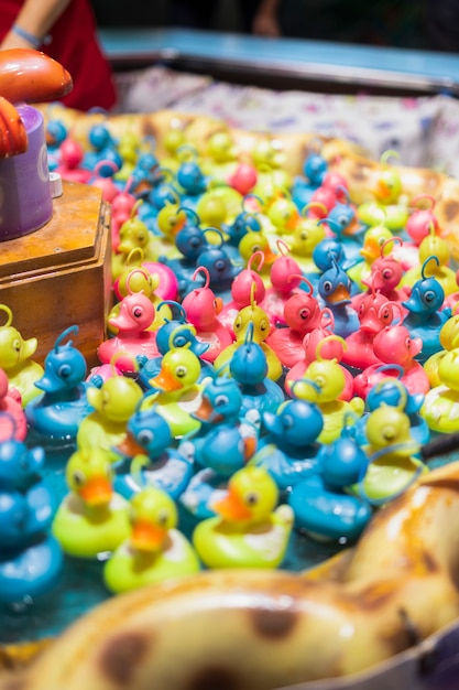 Toy duck fishing game with colorful toy ducks Free Photo