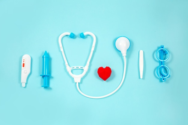 Toy medical devices on a blue. kids medical instruments. Premium Photo