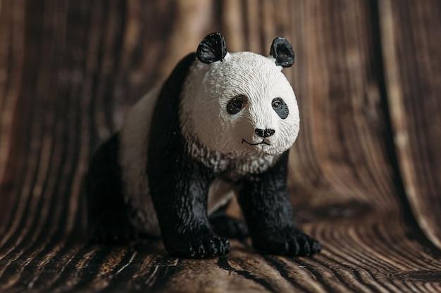 Toy panda figurine on wooden Premium Photo