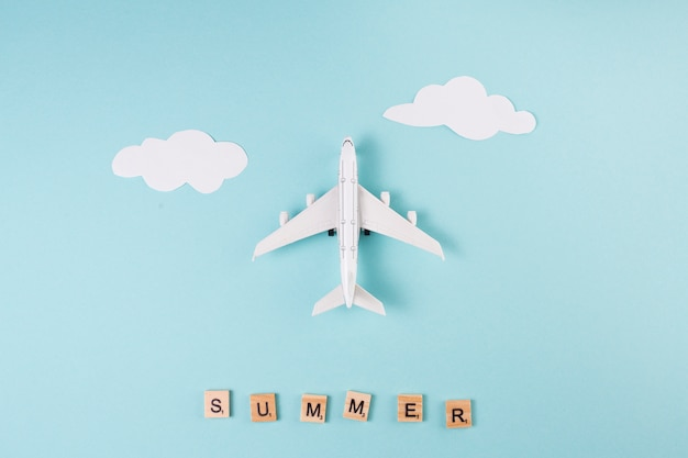 Toy plane paper clouds and letters Free Photo