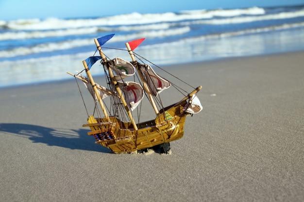 Toy ship on the seashore Free Photo