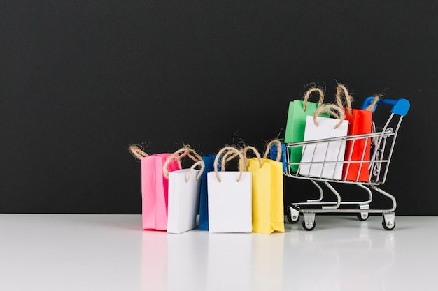 Toy supermarket cart with packets Free Photo