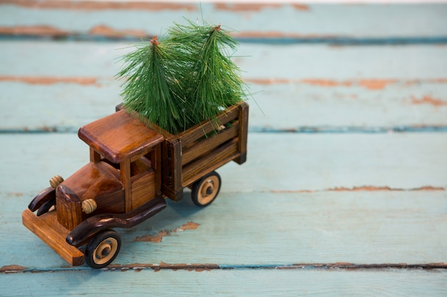 Toy truck with christmas trees Free Photo
