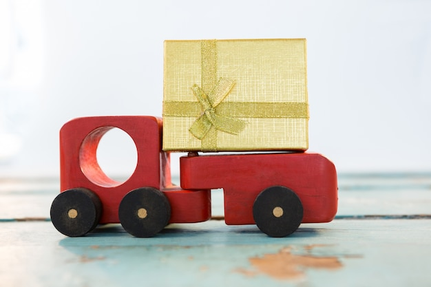 Toy truck with a golden gift Free Photo