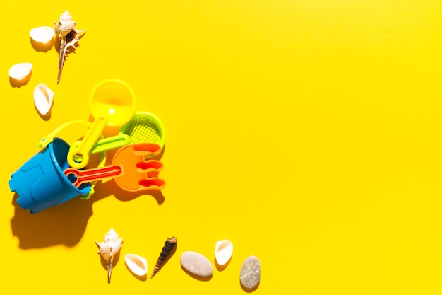 Toys and shells on bright background Free Photo