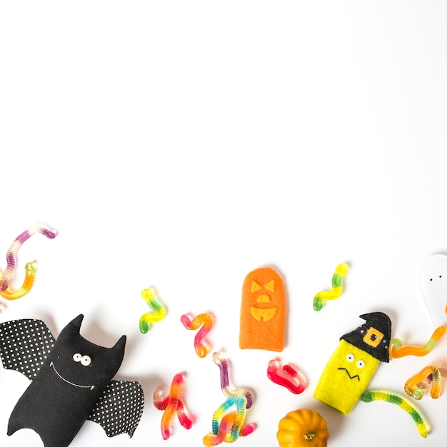 Toys and sweets for halloween Free Photo