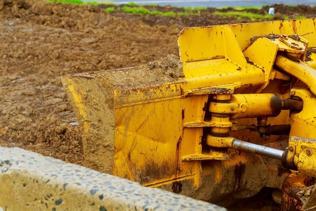 The tractor or bulldozer on construction site Premium Photo