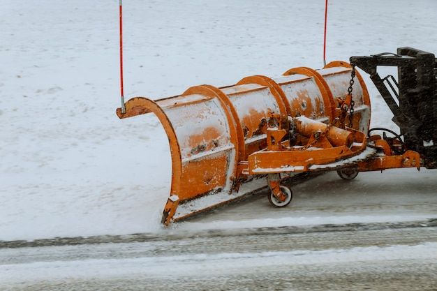 Tractor clears the way after heavy snowfall. Premium Photo