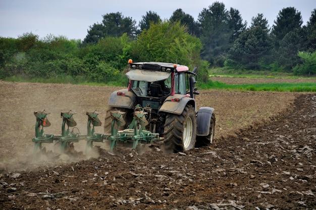 Tractor plowing Premium Photo