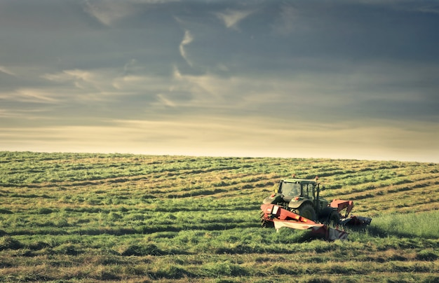 Tractor working on a farm Premium Photo