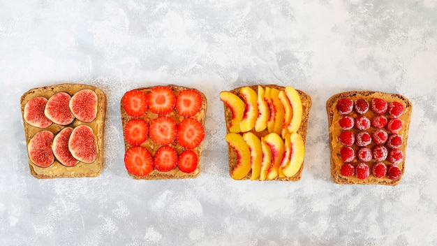 Traditional american and european summer breakfast: sandwiches of toast with peanut butter, copy  top view Free Photo