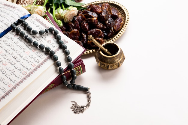 Traditional arabic dates and quran Free Photo