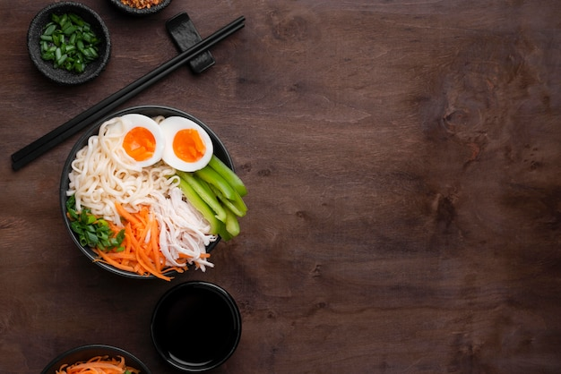 Traditional asian noodles with eggs and copy space Free Photo