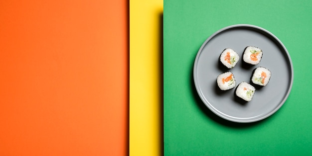 Traditional asian sushi rolls on abstract background Free Photo