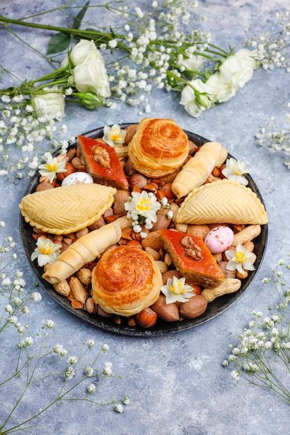 Traditional azerbaijan holiday novruz cookies baklavas and shakarburas on black tray plate on the gr